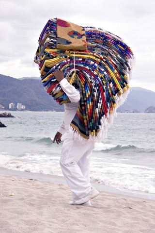 Mexican blanket seller on the beach Mexico